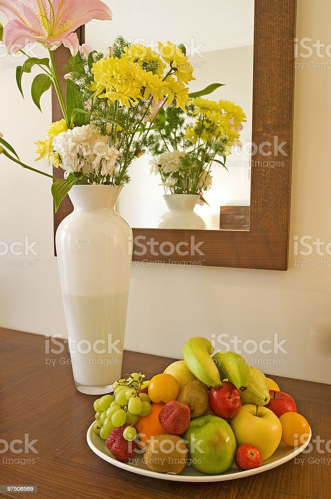 Fruit basket with vase of flowers royalty-free stock photo