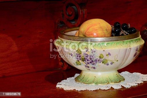 Antique Fruit Basket, Decorative Fruit Bowl, artificial fruit as a central piece of table decoration.