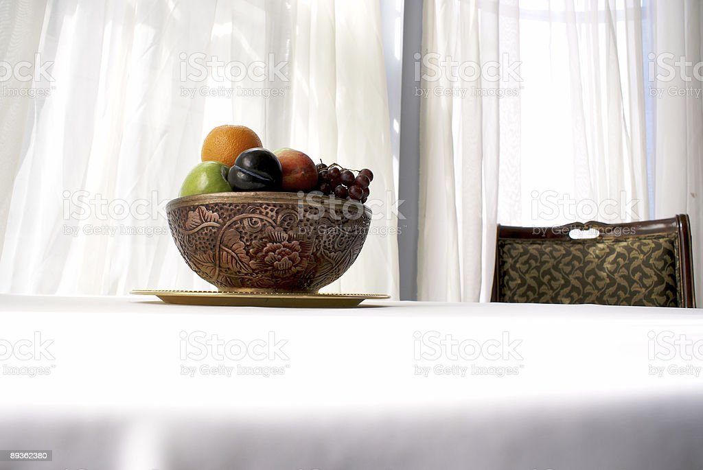 fruit bowl with chair royalty free stockfoto