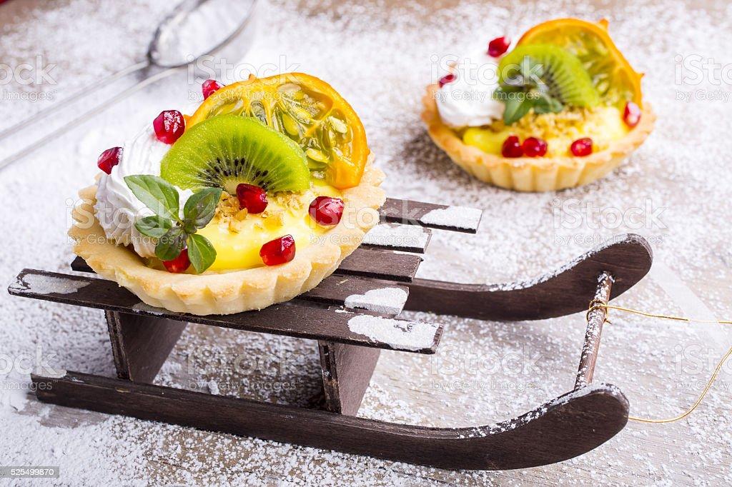 Fruit Cake on sledge, Christmas decorations stock photo