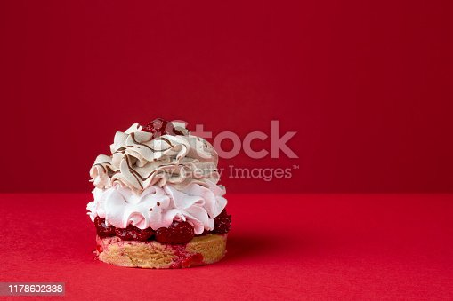 Fruit cake isolated on red