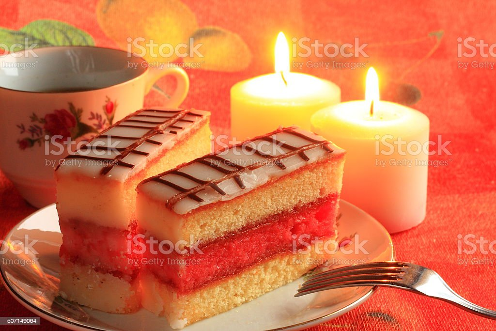 Fruit cake with coffee with candles in the background stock photo