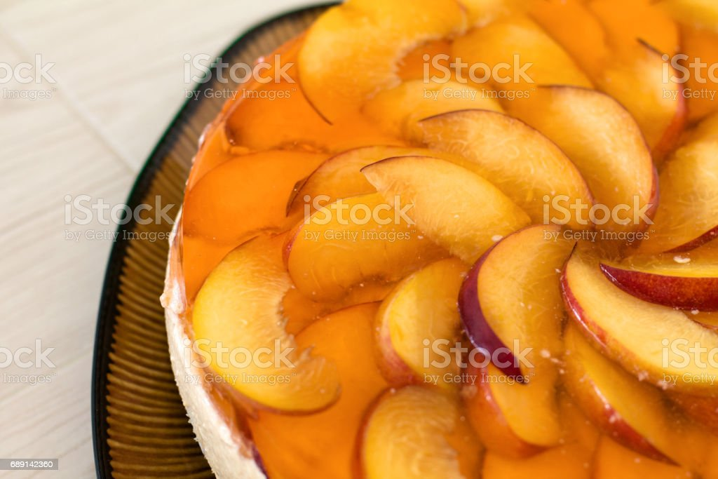Fruit cake with peach, jelly and mousse. stock photo