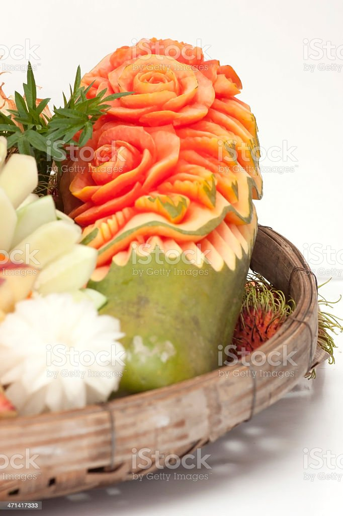 Fruit carvings are arranged on a tray stock photo