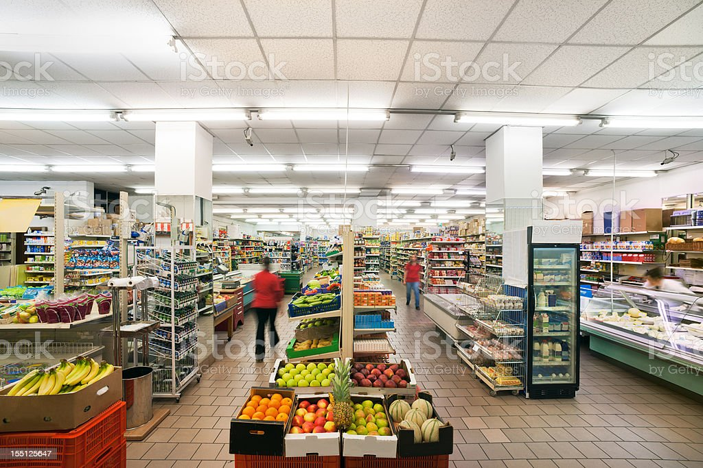 Fruit department in a small italian supermarket with neon lights royalty-free stock photo