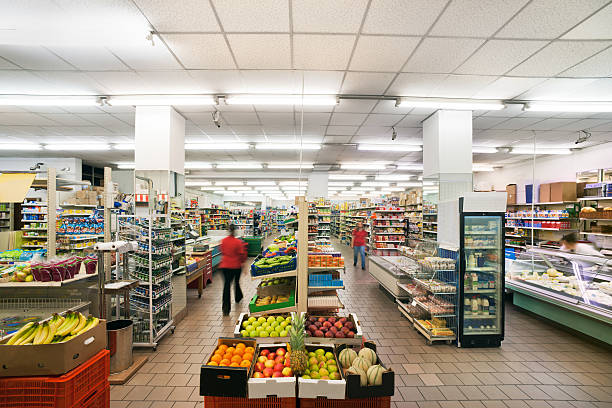 Fruit department in a small italian supermarket with neon lights stock photo