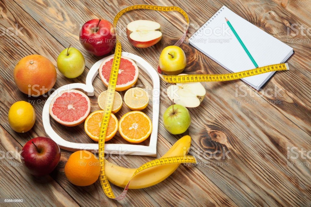 Fruit Diet, centimeter and plan on a wooden background stock photo