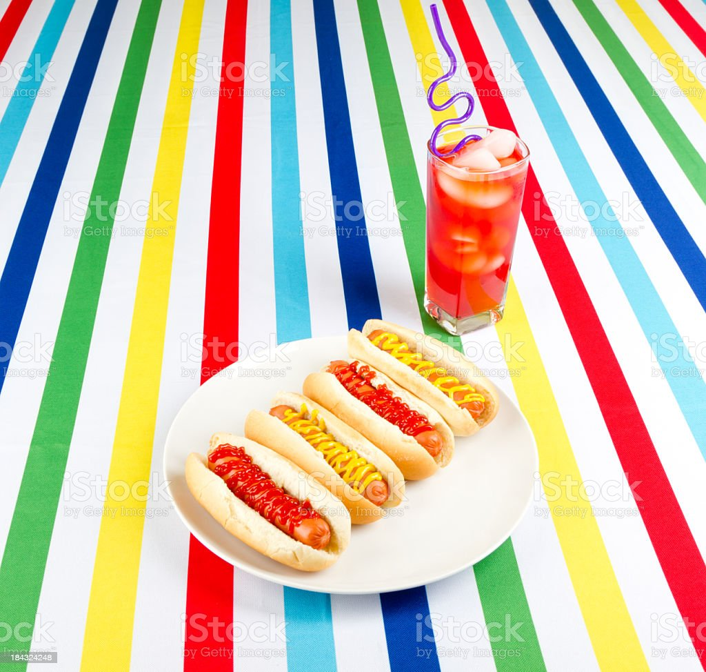 Fruit drink and hotdogs royalty-free stock photo