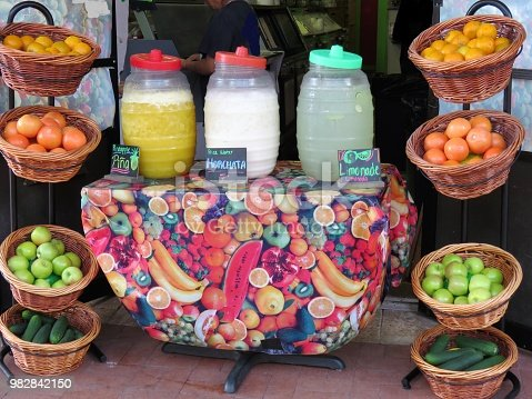 fruit drinks (names in Spanish) and fruit for sale