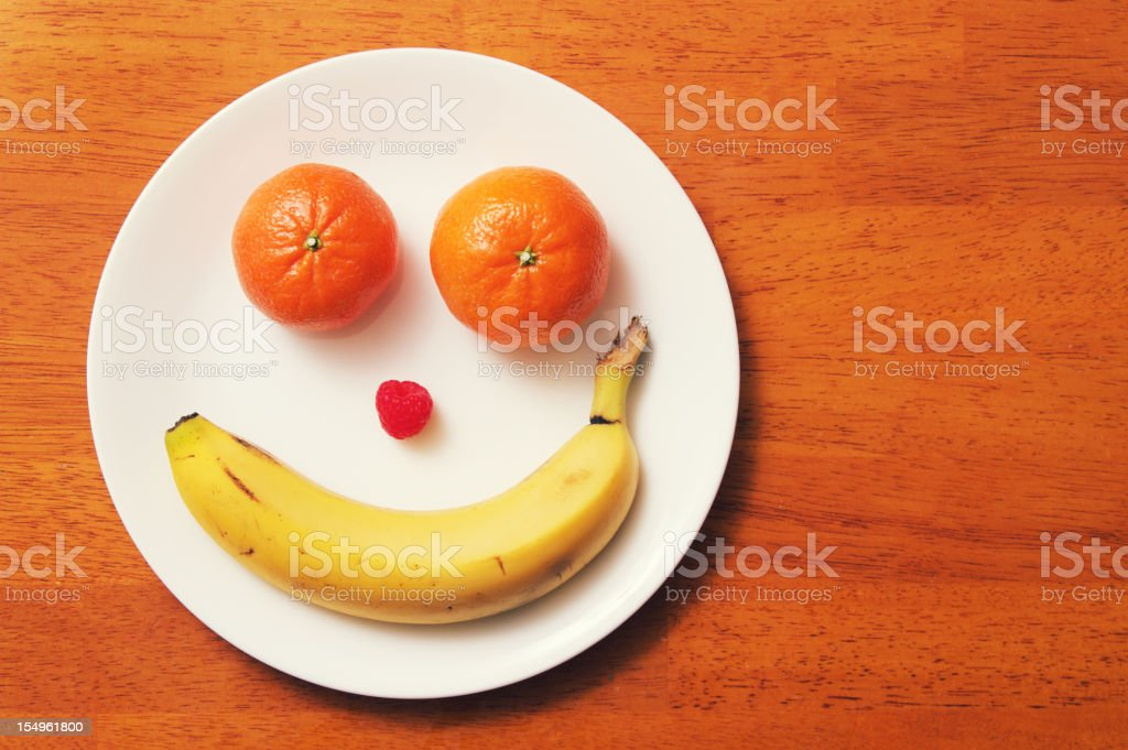 Fruit Face Plate stock photo