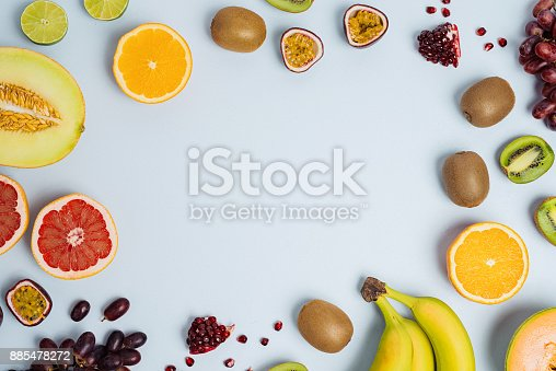 istock Fruit flat lay from above colorful food background 885478272