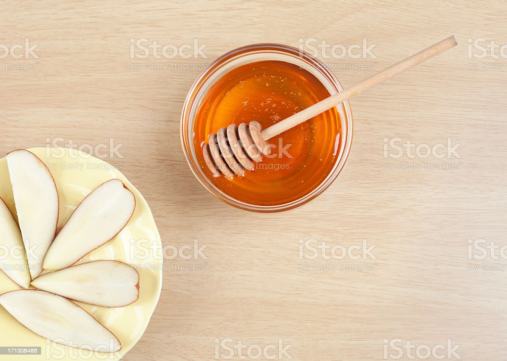 Fruit getting served with honey in glass bowl stock photo