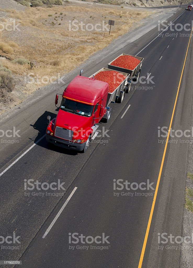 Fruit Hauler Semi Truck Hauls Tomato Crop over California Highway royalty-free stock photo