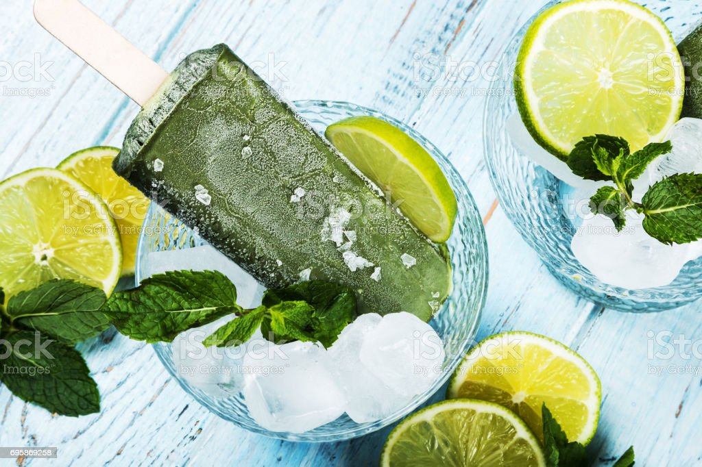 fruit ice cream on a stick with lime and lemon stock photo