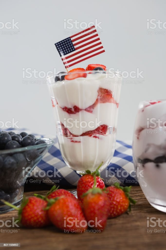 Fruit ice cream on wooden table stock photo