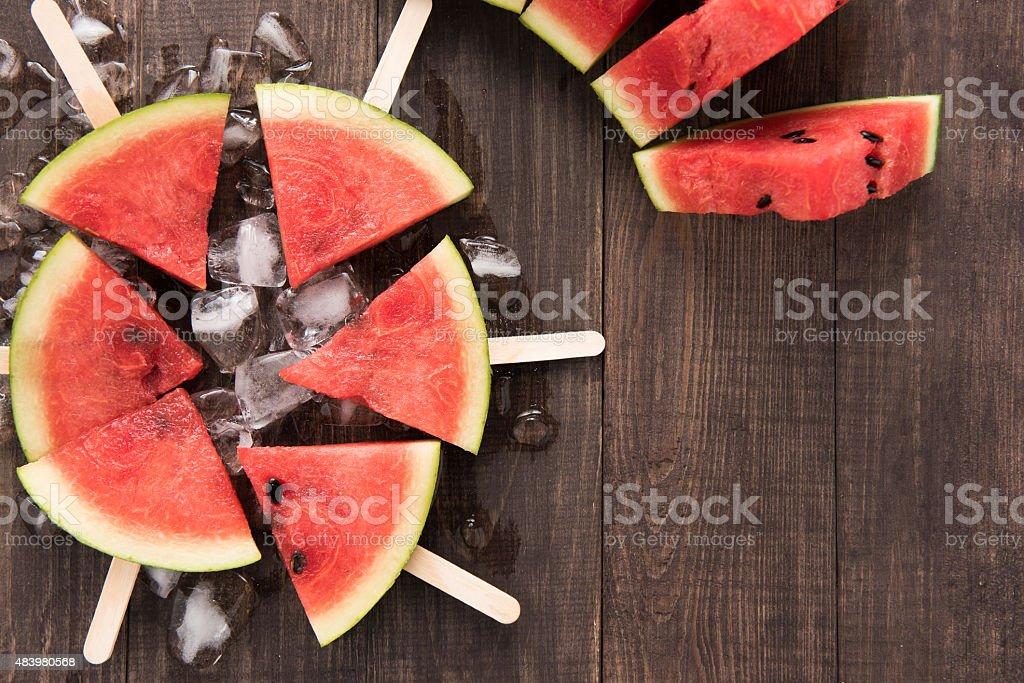 Fruit ice cream sliced watermelon on wooden background Fruit ice cream sliced watermelon on wooden background. 2015 Stock Photo