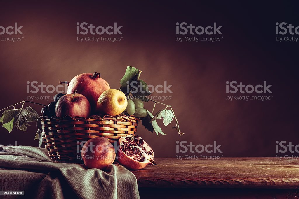 Fruit in a basket still life stock photo