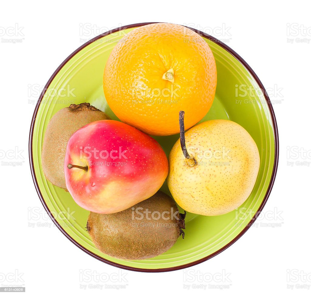 Fruit in a green plate stock photo