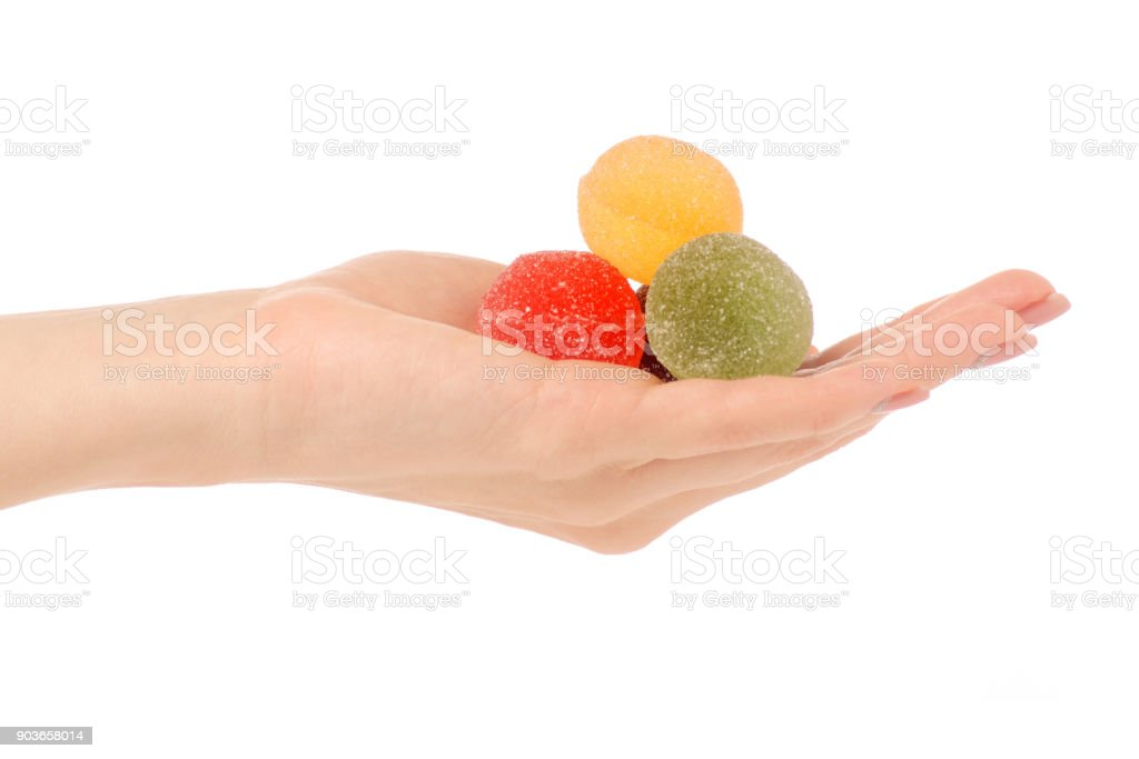 Fruit jelly in sugar in hand stock photo