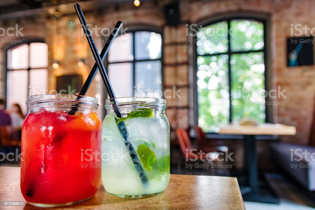 Fruit juice and lemonade with ice in a restaurant. stock photo