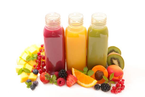 jus de fruit, smoothie - jus de fruit photos et images de collection