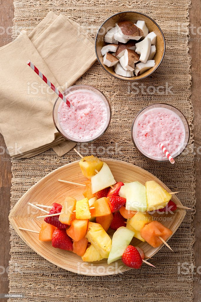 Fruit kebabs and strawberry smoothies for two stock photo