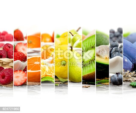 Photo of rainbow colorful mix stripes with fruit and slices; healthy eating concept; white space for text