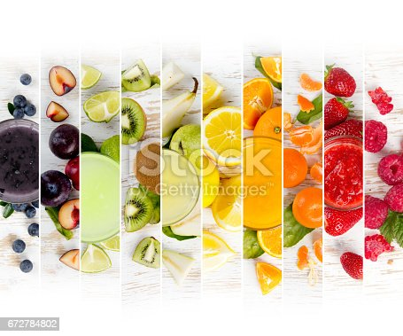 Top view of rainbow colorful mix stripes with fruit, drinks and slices; healthy eating concept; white space for text