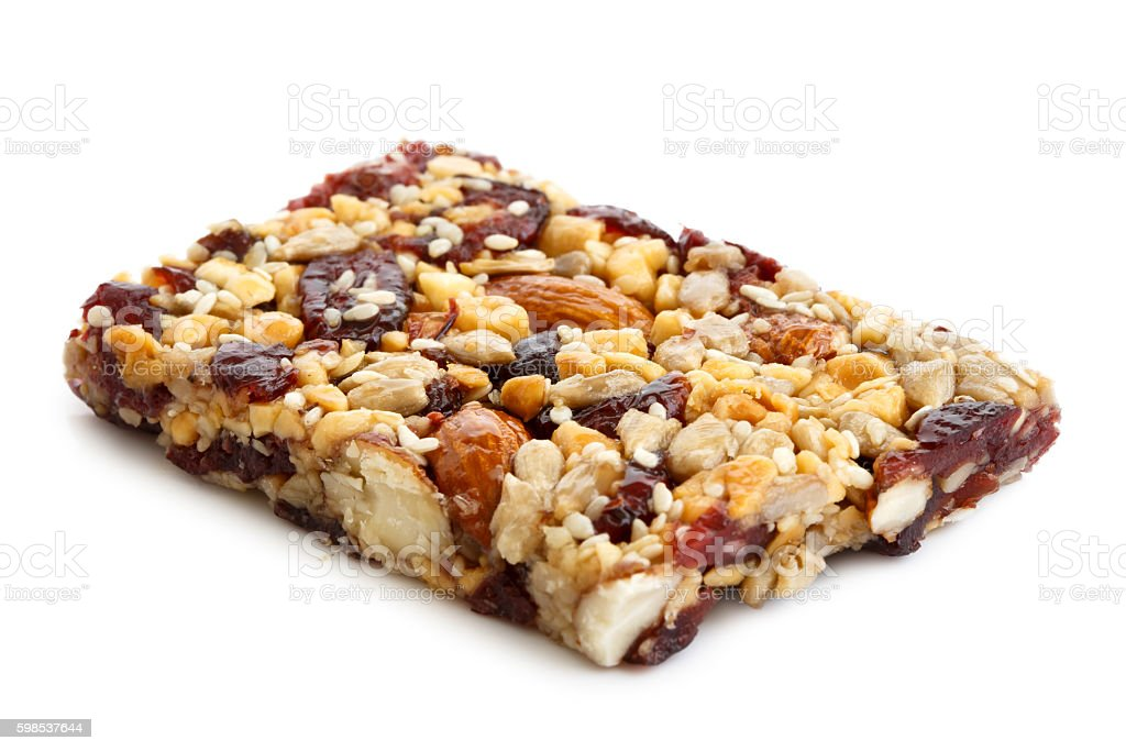 Fruit, nut and seed bar with cranberries isolated on white. photo libre de droits