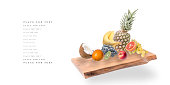Fruit falling on the Board on a white background.