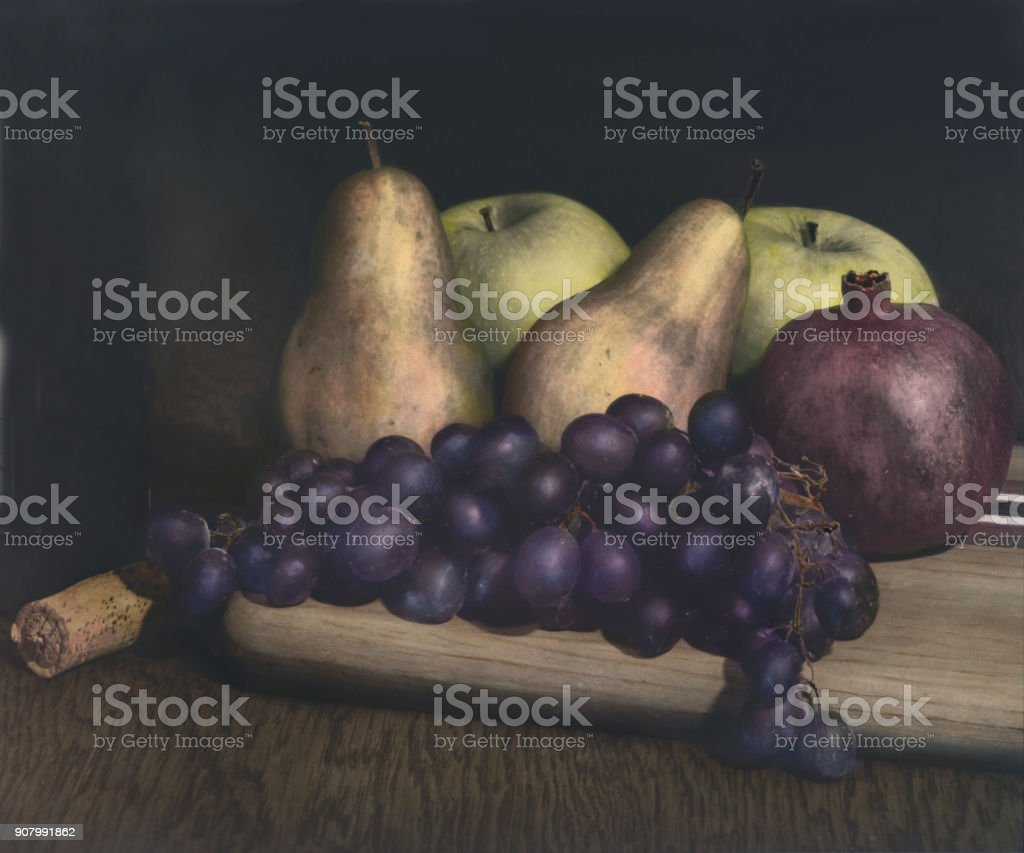 Fruit On Cutting Board With Wine Bottle And Cork stock photo