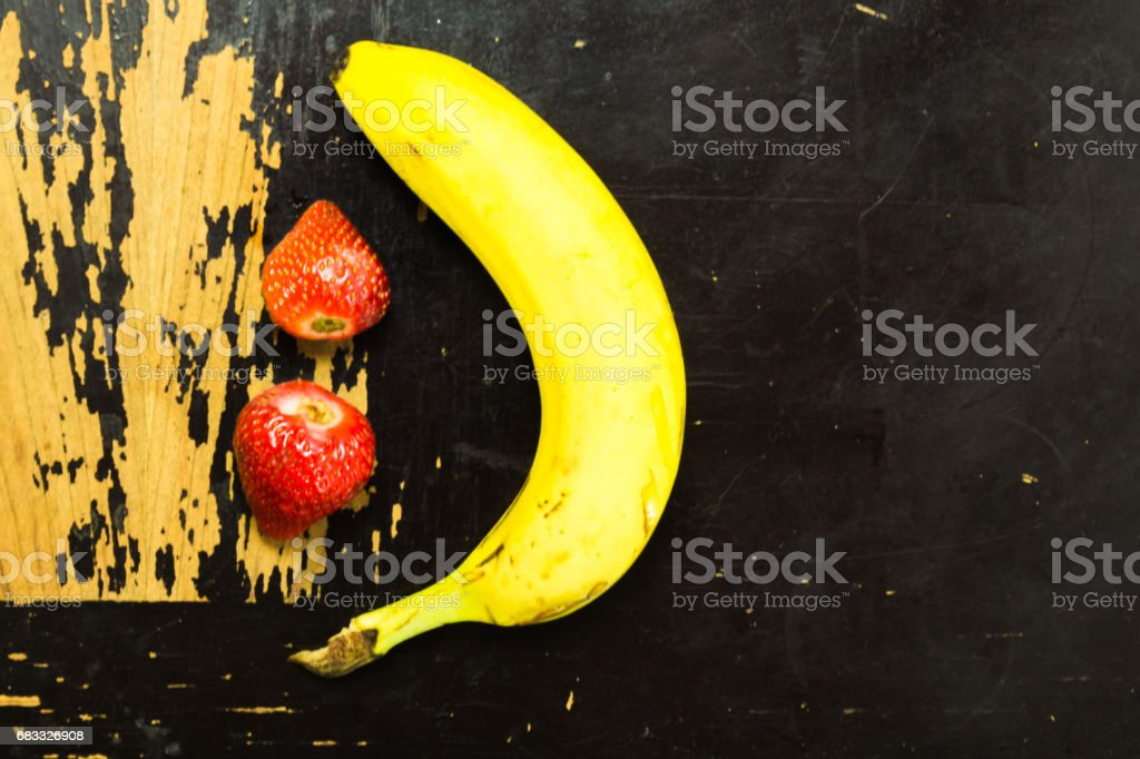 Fruit on scratchy wooden surface royalty-free stock photo