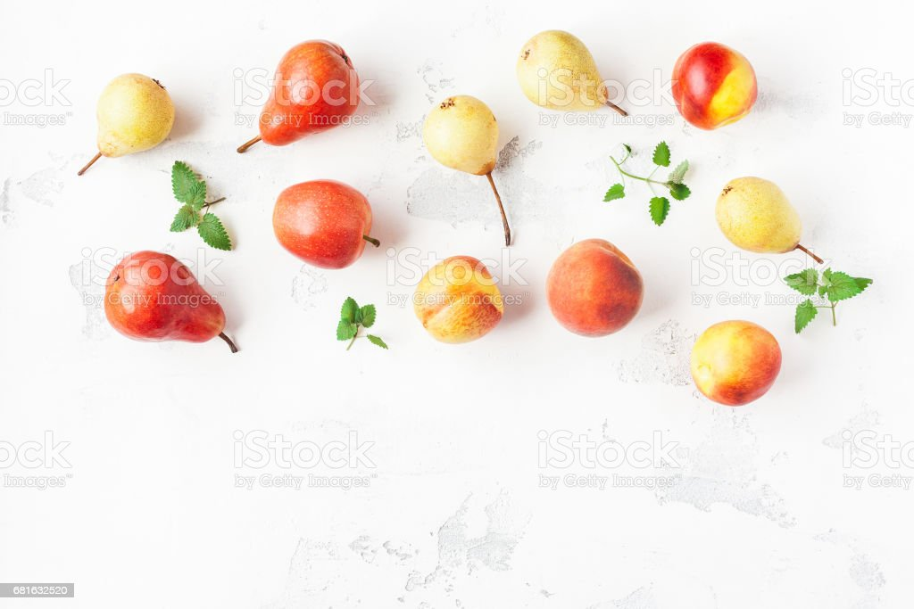 Fruit on white background. Pears, apples, peaches, nectarines stock photo