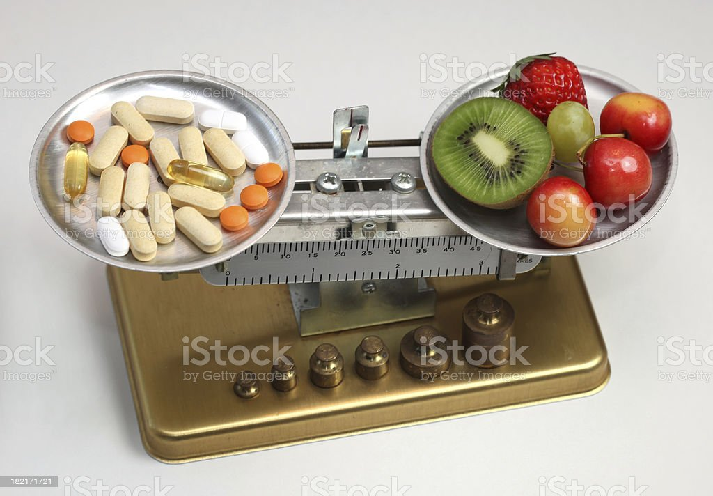 fruit or pills stock photo