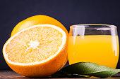 Fruit orange juice. Fresh citrus food and drink, beverage in glass. Healthy organic vitamin sweet, juicy refreshment. Liquid for health. Color background. Slice of diet summer breakfast.
