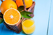 Fruit orange juice. Fresh citrus food and drink, beverage in glass. Healthy organic vitamin sweet, juicy refreshment. Liquid for health. Color background. Slice of diet summer breakfast.