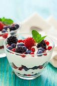 Delicious parfait with fresh fruits,yogurt and granola