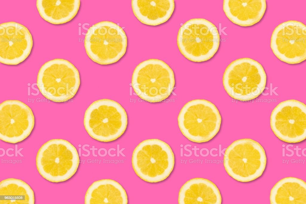 Fruit pattern of lemon slices on a pastel pink background stock photo