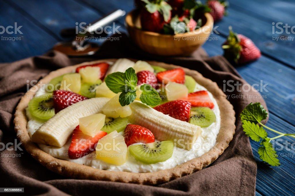 Fruit pizza with banana, kiwi, strawberry, pineapple royalty-free stock photo