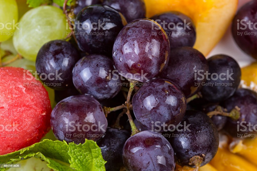 Fruit platter - grapes and melon royalty-free stock photo