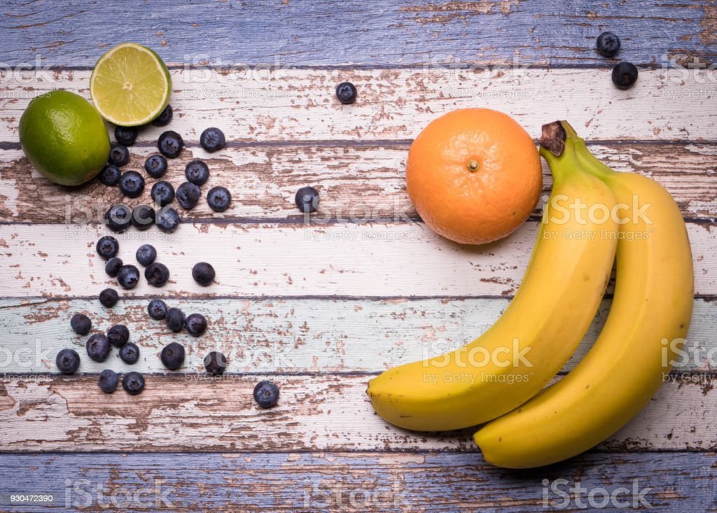 fruit platter on vintage wood background stock photo