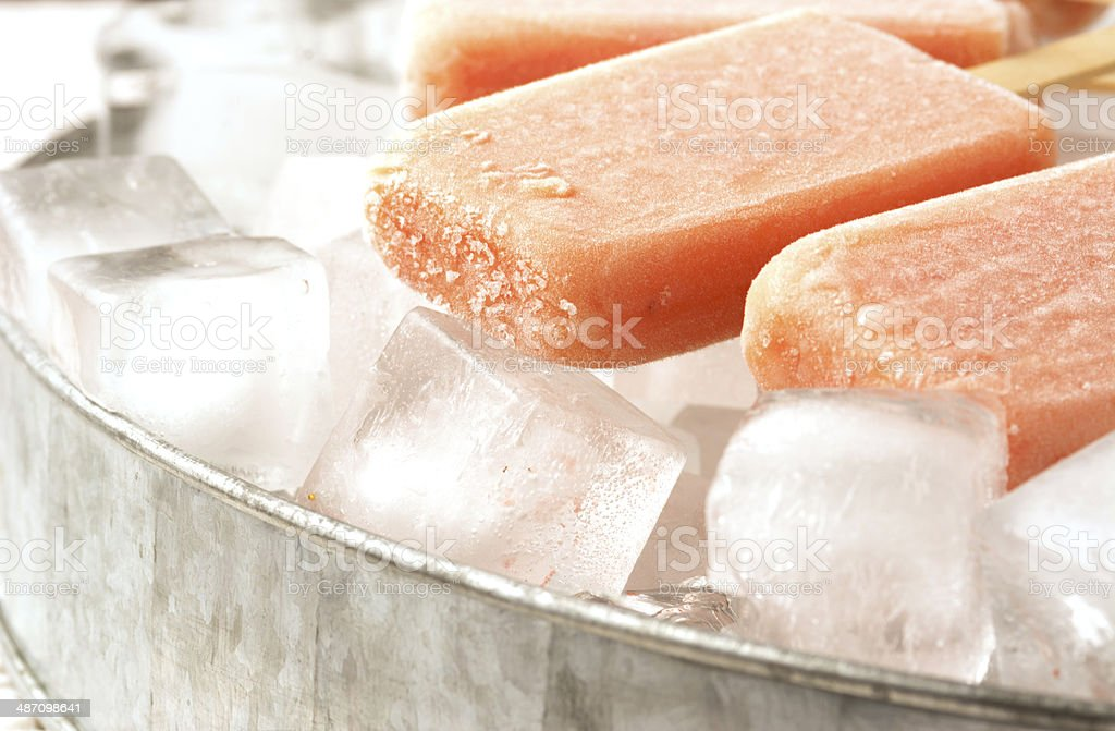 Fruit Popsicles on Ice with Strawberry, Orange, Pineapple, Mango stock photo