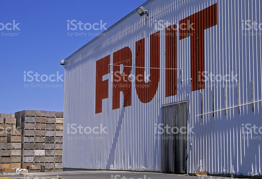 Fruit processing plant and empty apple containers stock photo