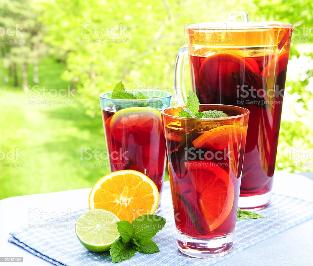 Fruit punch in pitcher and glasses royalty-free stock photo