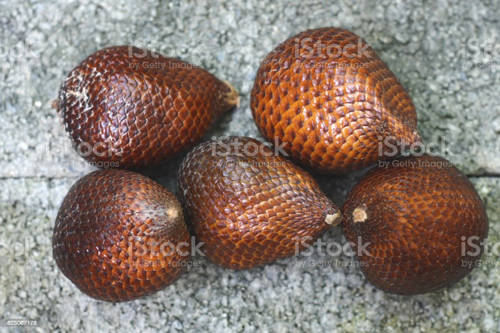 fruit Salacca zalacca wallichiana brick background. stock photo