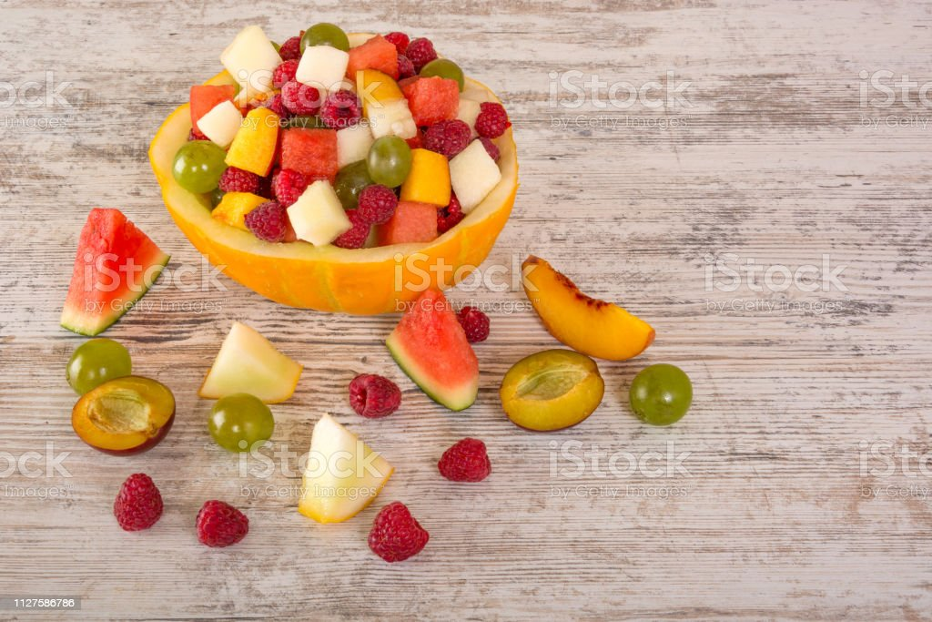 Fruit salad. Peach, watermelon, melon, raspberry, plum, grapes, diced...