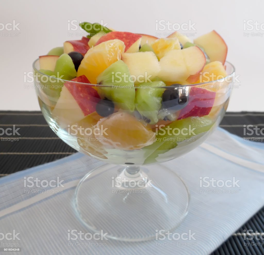 fruit salad on a darkbackground orange kiwi apple mandarin
