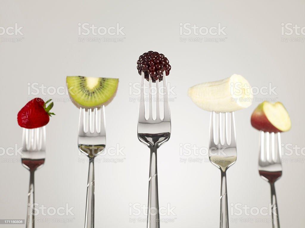 Fruit salad on forks royalty-free stock photo