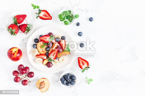 640978994 istock photo Fruit salad on white background. Flat lay, top view 924348358