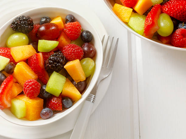 Fruit Salad Fruit Salad - Photographed on -Photographed on Hasselblad H3D2-39mb Camera fruit salad stock pictures, royalty-free photos & images